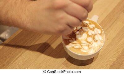 Making coffee, finalePutting figure on the coffee