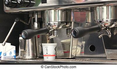 Making coffee in a coffee machine.