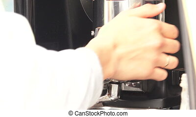 Making coffee in a coffee machine.