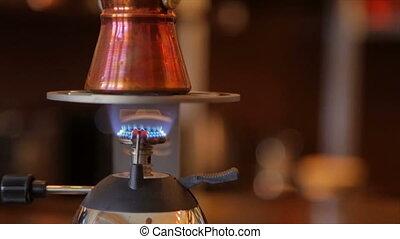 Making coffee in a Turkish - Making Turkish coffee indoors