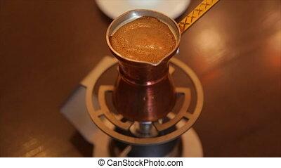 Making coffee in a Turkish - Making Turkish coffee...