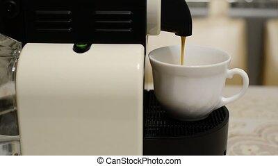 Making coffee in  capsule coffee machine