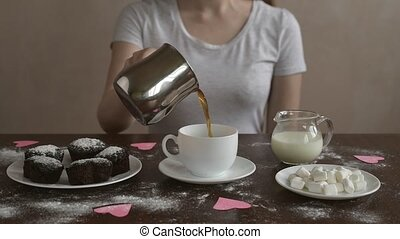 Making coffee with milk and marsh mallow - Woman making ...