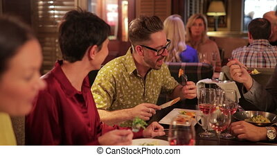 Making Conversation at Dinner - Mature couple sitting at a...
