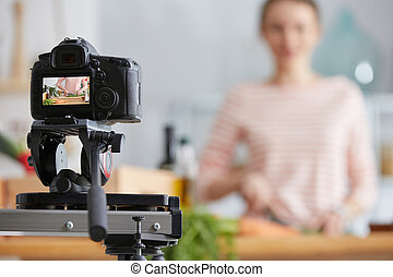 Making cooking vlog about healthy cuisine and vegan lifestyle