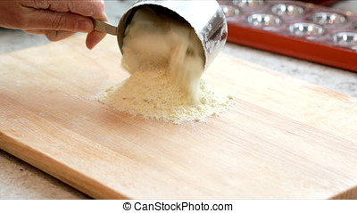Making Fresh Pasta - Pouring semolina flour on board for...