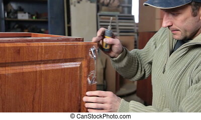 making furniture - Carpenter is manufactured kitchen...