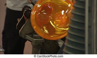 Making glass work from scratch - A tilt up shot of a man...