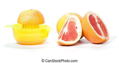 Making grapefruit juice, isolated on white