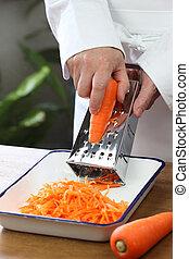 making grated carrot salad, shredding carrots