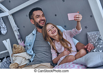 Making great memories. Young father and his little daughter...