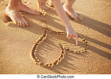 making heart on the beach