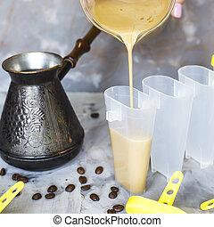 Making homemade coffee ice cream with milk