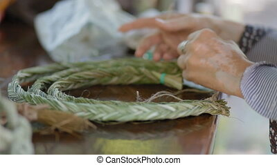 Making jewelery from natural materials - Woman making...