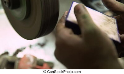 Making Jewelry - A close up shot of a stones being made in...