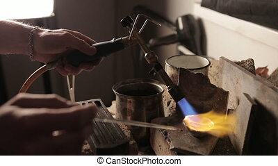 Melting of silver by a blowtorch