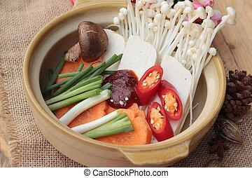 Making Korean tofu soup delicious.