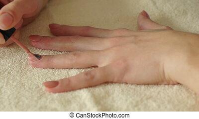 Making Manicure - Woman makes manicure.