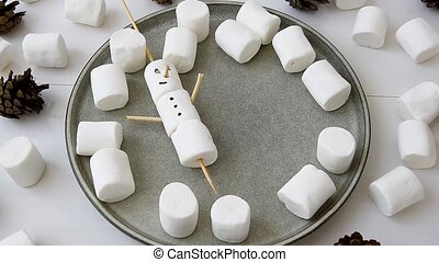 Making marshmallow snowmen and reindeer on sticks. Christmas...