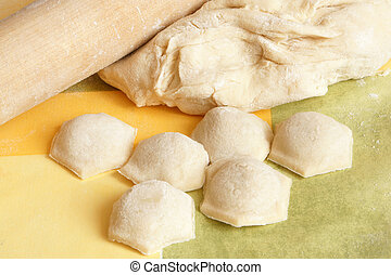Making meat dumplings. Traditional russian food.