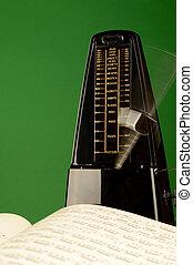 A closeup view of a metronome to make some music.