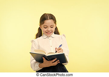 Making notes. Child school uniform kid doing homework. Child...