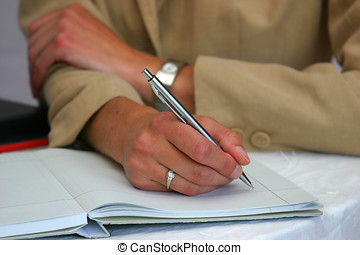 Businessman making notes in his notebook and look very serious