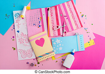 Making of cute greeting cards. Colored paper, scissors and glue