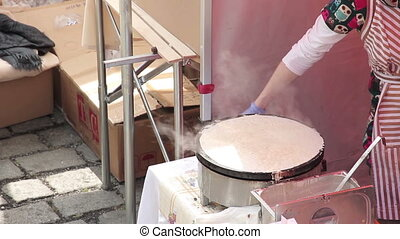 Making of pancake - Middle aged caucasian woman making...