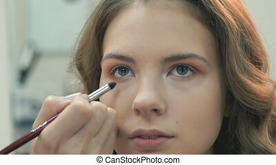 Making of professional make-up for beautiful girl