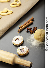 making of spritz biscuits with a rolling pin