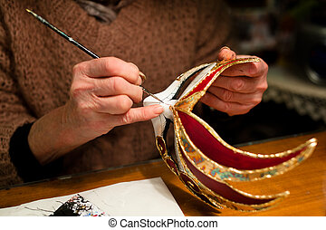 Making of venice carnival mask - Woman hands with venice...