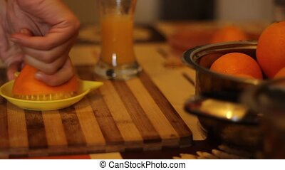Making Orange Juice Fresh - Oranges are squeezed by hand to...