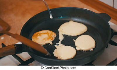 Making Pancake, Crepes, Flapjack on Frying Pan in a Domestic...