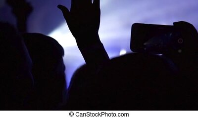 Making party at a rock concert. Hands hold cameras with digital displays