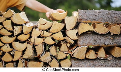 Making pile of logs outdoors