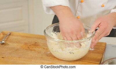 Making potato dough for dumplings or gnocchi