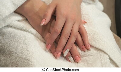 Making professional manicure in beauty salon