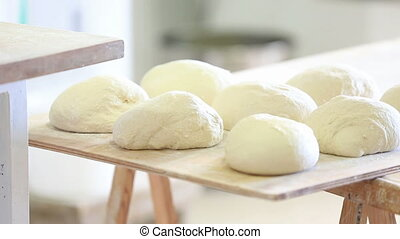 Making rustic bread - Working in a bakery, preparing rustic...