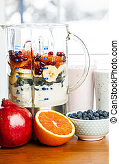 Making smoothies in blender with fruit and yogurt - Prepared...