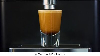 Making strong espresso at exclusive coffee machine