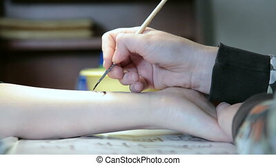 Making temporary henna tattoo