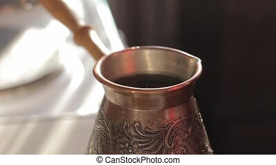 Making traditional turkish coffee in vintage bronze