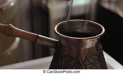 Making traditional turkish coffee in vintage bronze.
