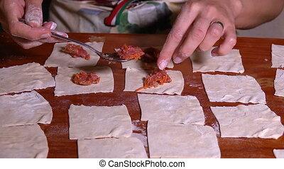 Making Turkish Ravioli Pasty named Manti