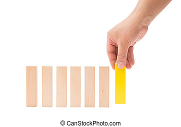 making up a line of wooden toy blocks on white background with clipping path