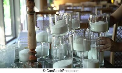 Making white candles indoors. Woman candle maker