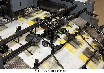 newspapers at offset printed machine - making yellow...