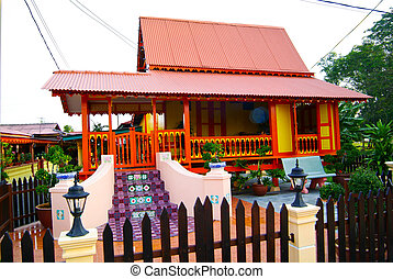MALACCA, MALAYSIA - aug 4 : Traditional Malay House at Kampung Morten on aug 4, 2007. Kampung Morten is one of Malaysian national heritage site located next to the Malacca River
