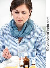 malade, jeune femme, prenant médicament